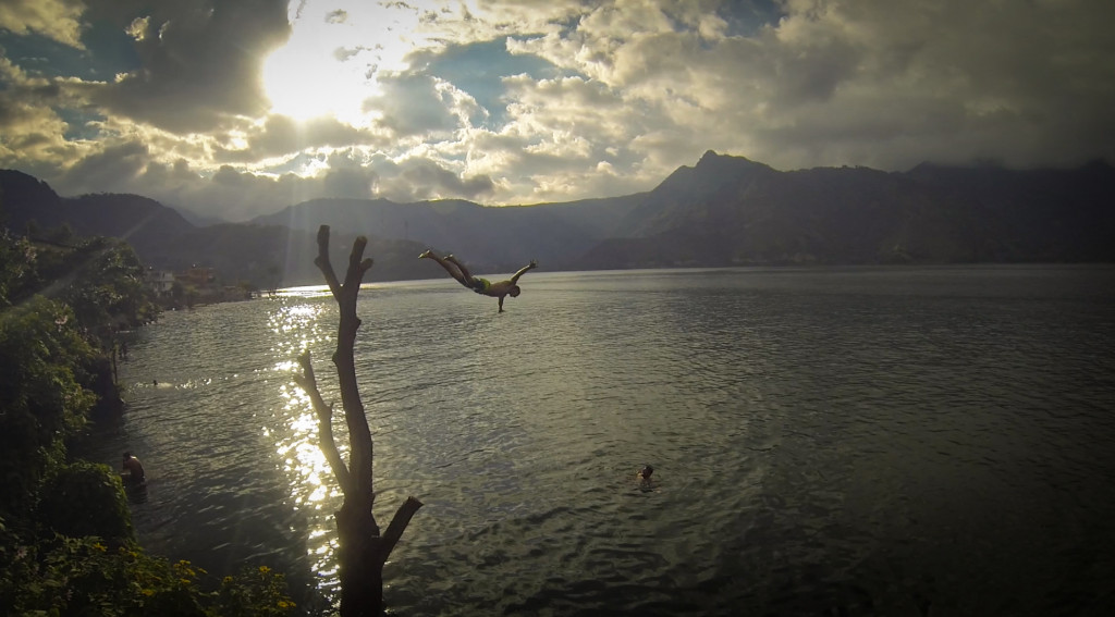 Swimming and rock jumping at Lake Atitlan. This is Trevor diving from the tree.