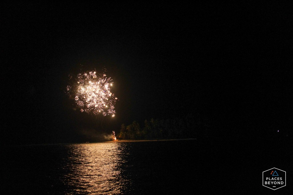 Late in the night a nearby luxury yacht crew launched fireworks from the island.